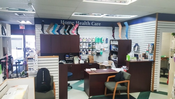 a Home Health Care section of a pharmacy with a desk and chair for customer service