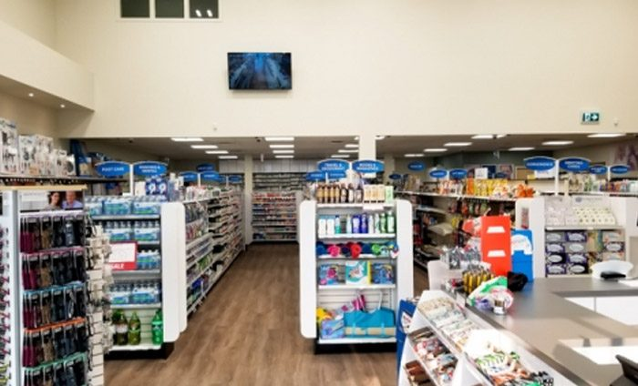 aisles filled with products in a pharmacy store